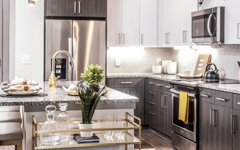 open kitchen with island and pendant lights